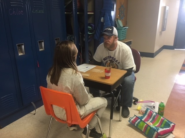 Mr. Swatosh playing multiplication game with student